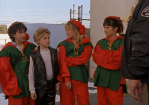 Main characters from Lizzie McGuire wearing elf costumes