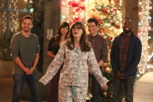 Jess standing in front of Nick, Cece, Schmidt, and Winston in Christmas pajamas