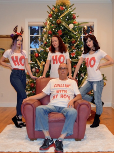 three women with shirts that say ho and a man with a shirt that says chillin' with my ho's