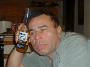 Man slouched with a Corona beer in his hand