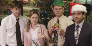 Characters from The Office posing for a picture in Christmas clothing