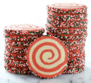 Cookies with a red swirl and sprinkles on the edges