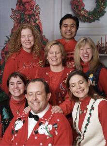 seven people posing for a christmas card and everyone blinked